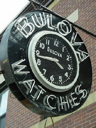 Sign with clock at Bulova Outlet Store