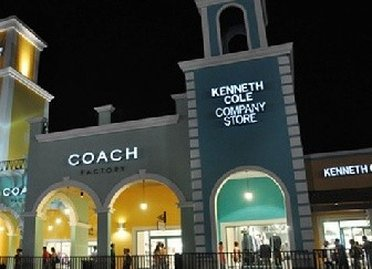 Evening view of the Kenneth Cole outlet store