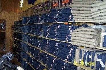 A wall of jeans at Wrangler outlet store