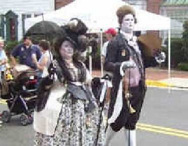 A couple parading outside Leesburg Outlet Mall