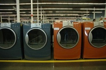 A bunch of washing machines inside a Sears Outlet Store